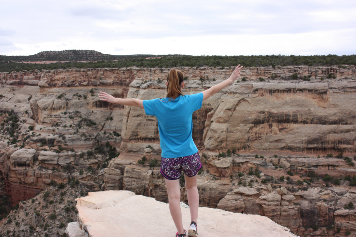 living on the edge, cliff, Colorado National Monument, Colorado, travel blogger