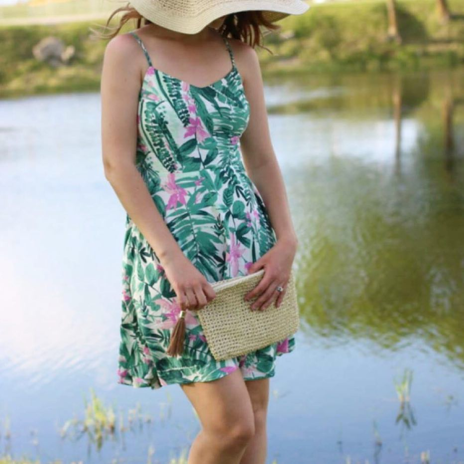 palm tree dress, floppy hat, tassel clutch
