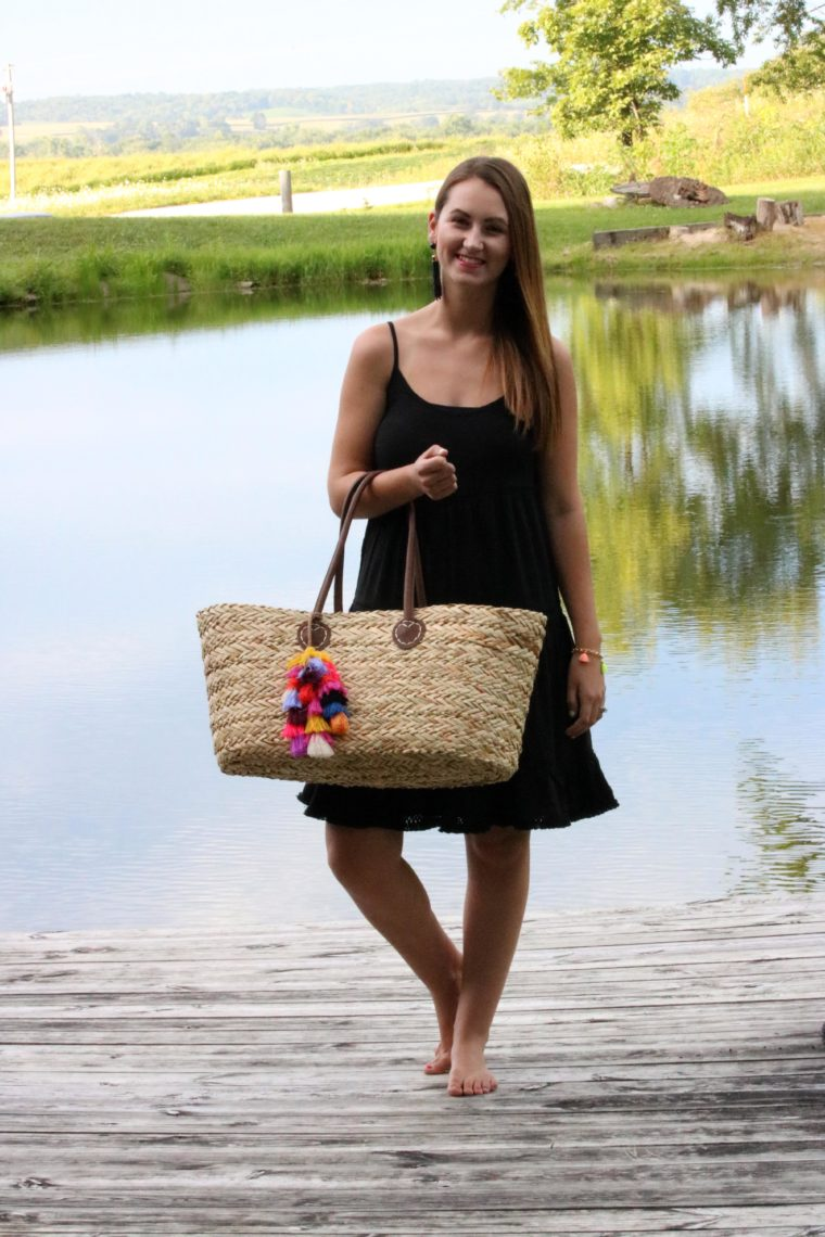 little black dress, tassel tote, blonde hair