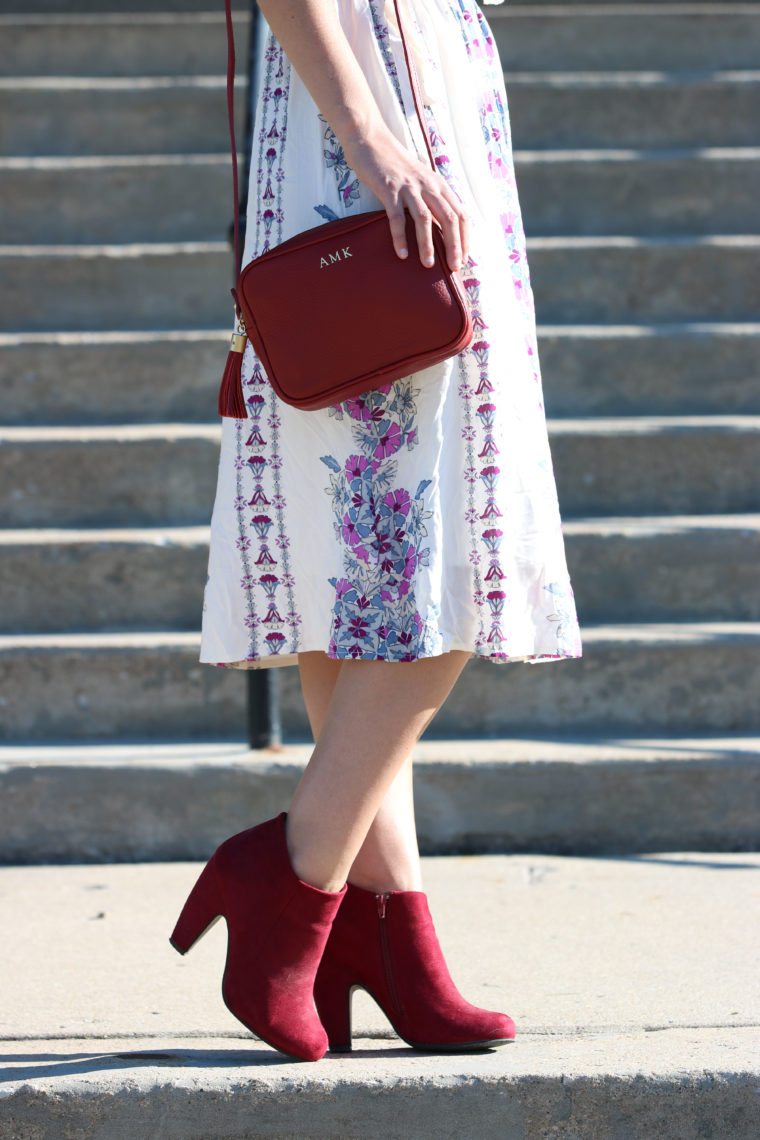 maroon booties, pattern dress, tassel bag