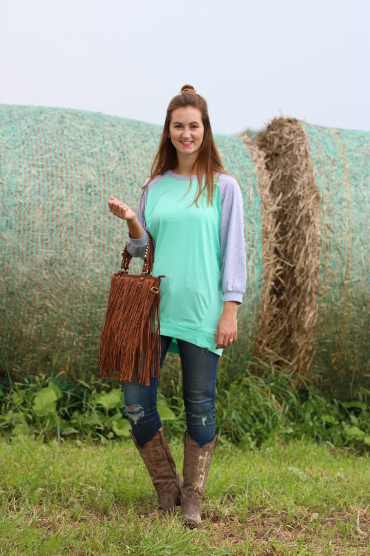 fringe bag, slouchie, top knot. cowgirl boots, country