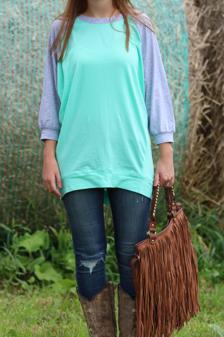 distressed denim, mint top, fringe bag