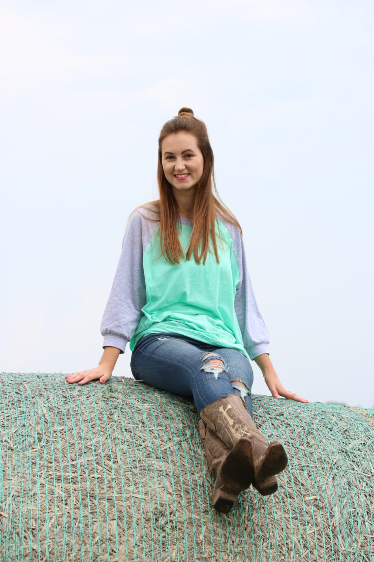 mint sweater, top knot, cowgirl boots, denim jeans