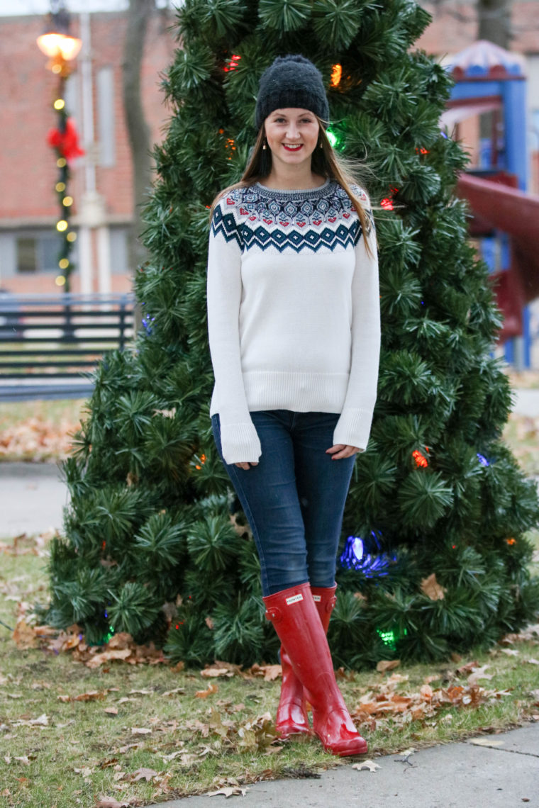 embellished sweater, holiday look, hunter boots, beanie