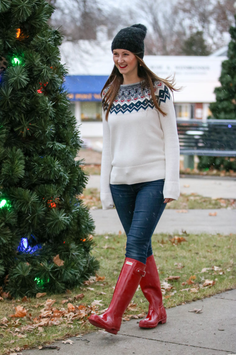 red hunter boots, holiday look, embellished sweater, black beanie