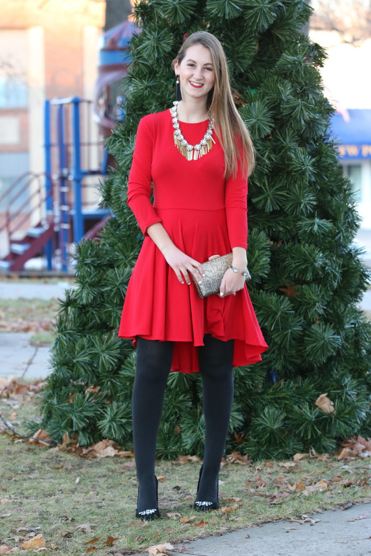 red dress, holiday look, statement necklace, gold clutch