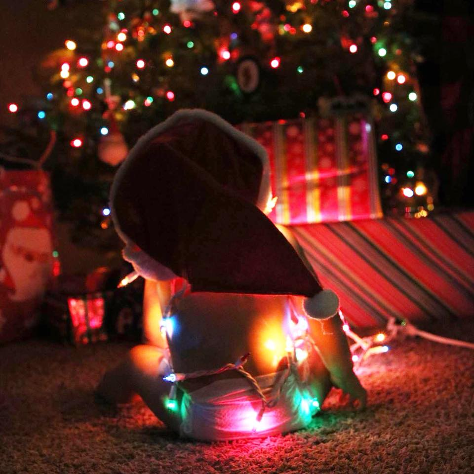baby with Christmas lights, baby in a diaper, baby Christmas photo