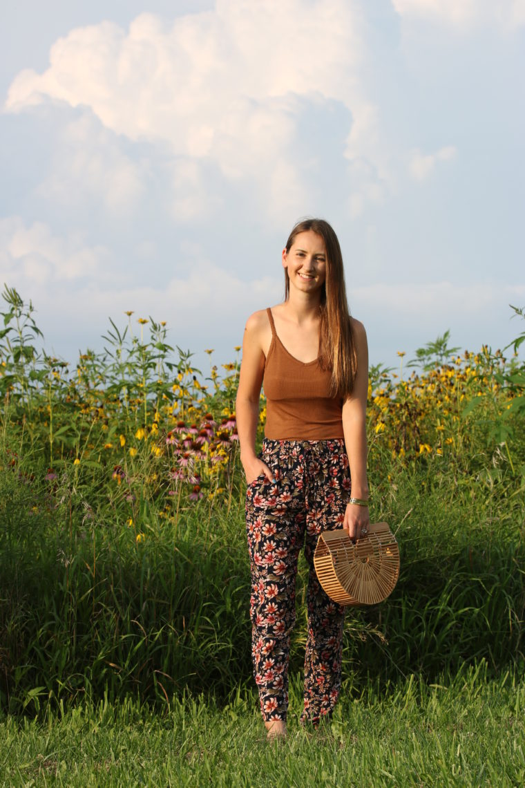 floral jogger pants, Cult Gaia bag, wildflower field